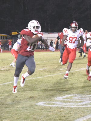 Larry Scott (10) takes the direct hand off and scampers up the right side of the field Friday night. He was being chased by the defense to the tune of 20-plus yards in the middle of the fourth quarter.