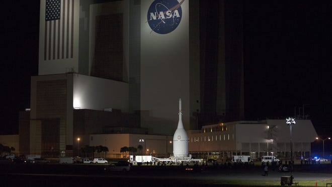 NASA's Orion spacecraft passes Kennedy Space Center's Vehicle Assembly Building as it is transported to Launch Complex 37 at Cape Canaveral Air Force Station.