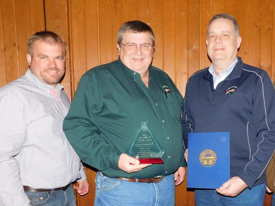 Luckey Farmers received the 2017 Agricultural Service Award at a Friday Ag Week breakfast. From left are Brice Gahler; Lindsey branch manager Phil Bodey; Bill Kuhlman and Dan Reif.