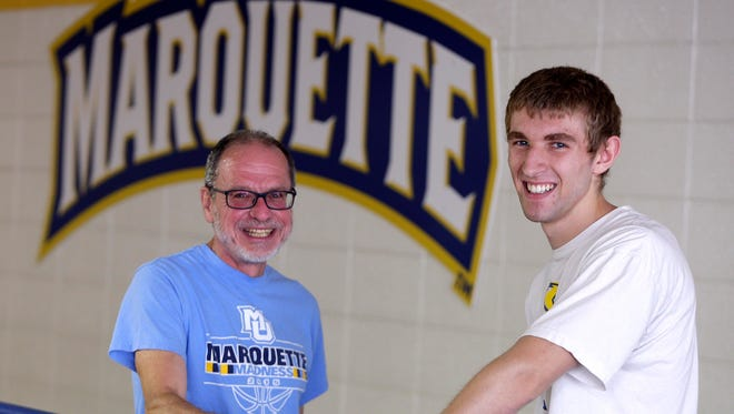 Gary Krenz, a math professor at Marquette University, and student Sam Scheel meet often at the Rec Plex, where they have shared many discussions about data science as the university was planning the major. Scheel is one of the first students to sign up for Marquette's new data science major, which combines math, computer science and statistics.