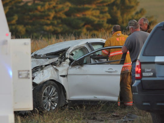 Authorities work the scene of an accident at 240th