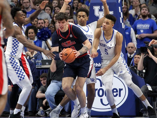 Mississippi's Dominik Olejniczak, middle, looks for an opening on Kentucky defenders, from left, Jarred Vanderbilt, Pj Washington, and Kevin Knox during the first half of an NCAA college basketball game, Wednesday, Feb. 28, 2018, in Lexington, Ky. (AP Photo/James Crisp)