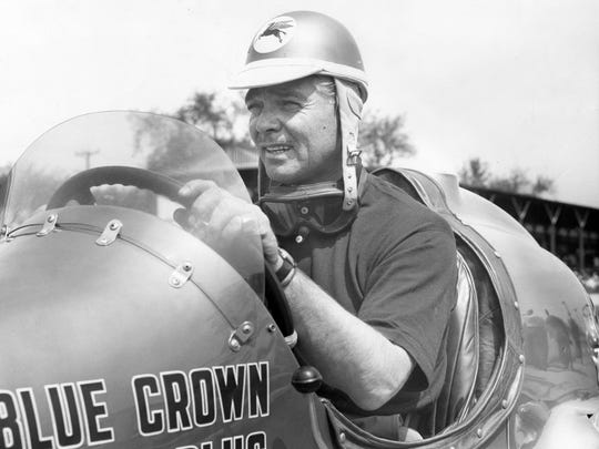 "Clark Gable sits in the Blue Crown Spark Plug Special at Indianapolis Motor Speedway during the 1950 filming of ""To Please a Lady."""