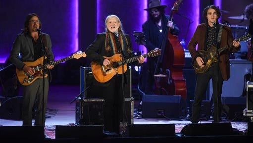 Willie Nelson sings with his sons, Lukas Nelson, left, and Jacob Micah Nelson after being presented with the 2015 Library of Congress Gershwin Prize for Popular Song on Wednesday, Nov. 18, 2015, in Washington.