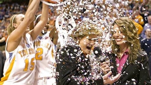 Tennessee coach Pat Summitt has confetti dumped on her by players Alicia Manning (15) and Alex Fuller (2) after the Lady Vols defeated Georgia 73-43 on Feb. 5, 2009, earning Summitt her 1,000th career coaching victory. Summitt, the winningest coach in Division I college basketball history who uplifted the women's game from obscurity to national prominence during her career at Tennessee, died Tuesday, June 28, 2016. She was 64.
