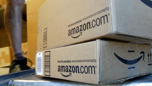 """FILE - In this June 30, 2011, file photo, a United Parcel Service driver delivers packages from Amazon.com in Palo Alto, Calif. A joke book """"written"""" by a conservative author and filled with blank pages in a dig at Democrats topped Amazon's list of best sellers on March 10, 2017."""