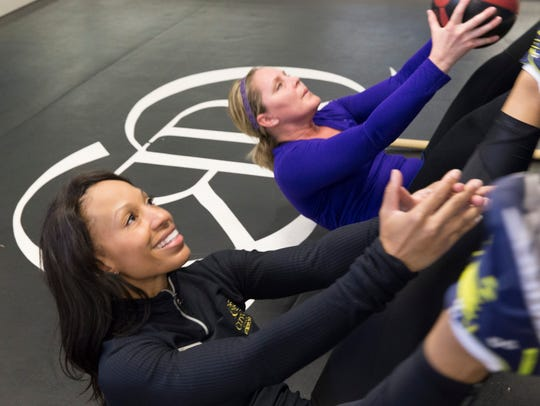 Personal trainer Dextria Sapp guides client Renee'