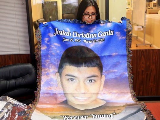 Marina Garcia holds a blanket she made with a photo of her son Josiah Christian Cantu on April 11, 2017, in Corpus Christi. Cantu died from a gun shot wound in the stomach last year. Corpus Christi Police initially said Cantu shot himself, but a year later Nueces County District Attorney Mark Gonzalez is seeking a criminal indictment against a friend.