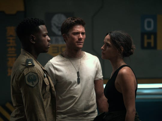 John Boyega (from left), Scott Eastwood and Adria Arjona
