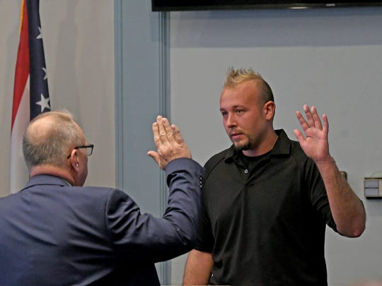 Nathaniel Keck is sworn in Wednesday morning during