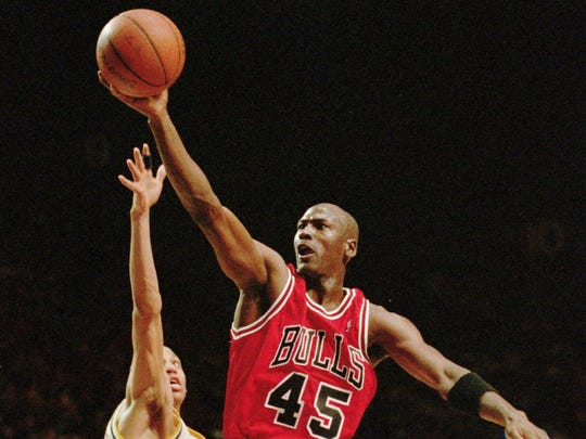 Chicago Bulls guard Michael Jordan flies to the hoop over the Indiana Pacers' Reggie Miller and Mark Jackson (13), March 19, 1995, in Indianapolis.