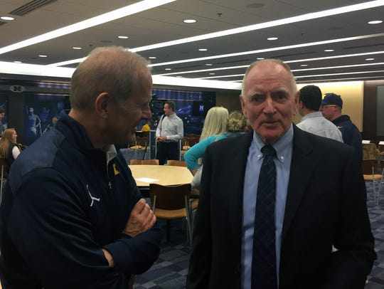 Michigan basketball coach John Beilein, left, and retiring