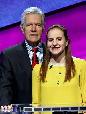 Watkins Glen special education teacher Rachel Niegelberg joins Jeopardy! host Alex Trebek while taping a segment of the show.