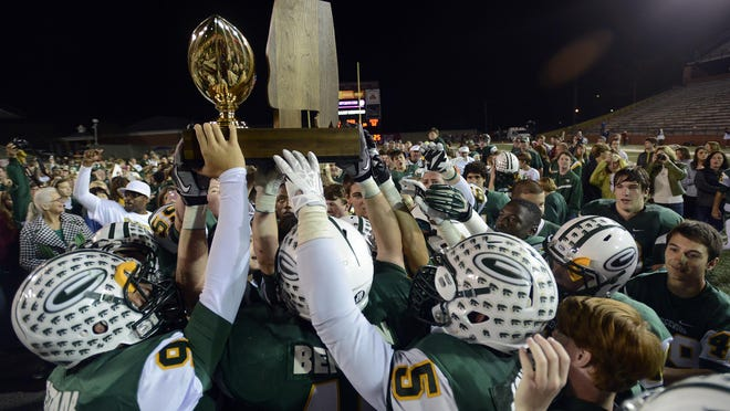 Edgewood celebrates winning its fourth straight AISA Class AA state football title last year in Troy. The Wildcats have been No. 1 in the 27 straight AISA rankings, and their last loss was on Oct. 22, 2010, against Glenwood.
