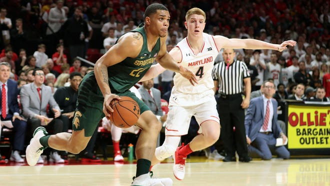 College Park, MD, USA; Michigan State Spartans forward Miles Bridges (22) defended by Maryland Terrapins guard Kevin Huerter (4) at XFINITY Center. Jan 28, 2018.