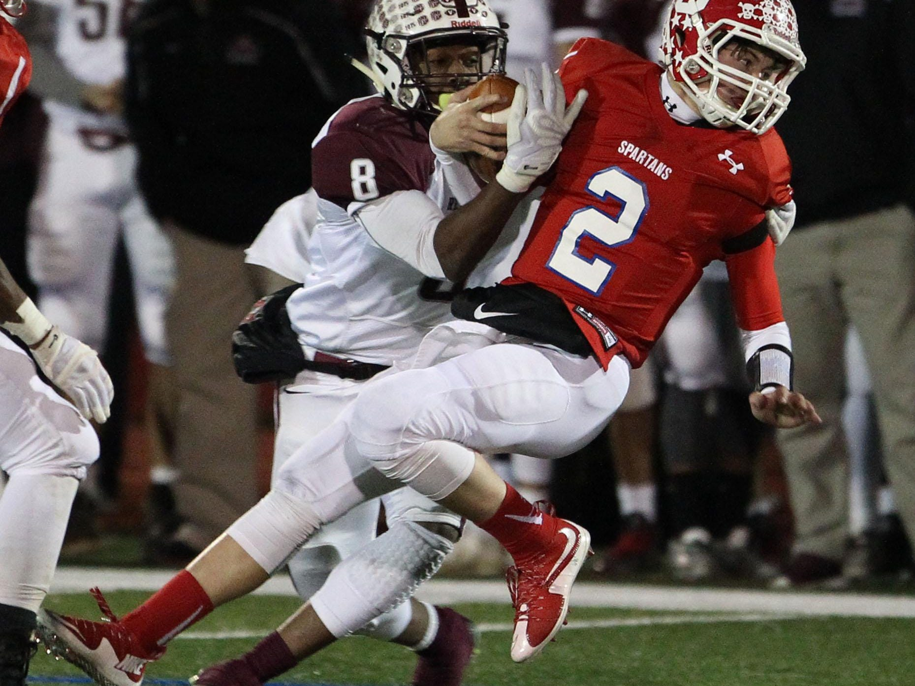 Kenny Pickett (2) of Ocean Twp. is tackled by Chris Outterbridge (8) of Red Bank Regional during NJSIAA Central Jersey Group III semifinal game at Ocean Twp. High SchoolOcean Twp.,NJ. Friday, November 20, 2015.Noah K. Murray-Special for the Asbury Park PressASB 1121 Ocean