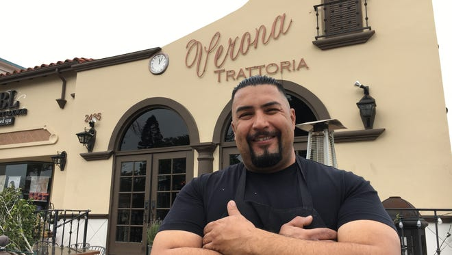 Julio Perez, chef at Verona Trattoria in Camarillo, poses in front of the restaurant his father founded in 1995. Perez and brother, Jerry Perez, plan to close the restaurant next month and open a new place elsewhere in Camarillo.