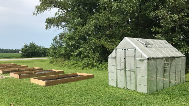 A greenhouse and four raised flower beds stand outside of Showell Elementary School for hands-on learning. 14 August, 2017.