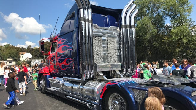 """Optimus Prime and several other characters from the """"Transformers"""" films visited Hendy Elementary School on Friday, Sept. 15, as part of a promotional tour for Twin Tiers Comic-Con."""