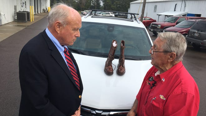 George Patton Waters, left, chats with car salesman Reuben Schaetzel at Buss Chevrolet in Shawano this week. The boots on the hood were Patton's; he wore them throughout the war and was wearing them when he was killed in a car crash in 1945.