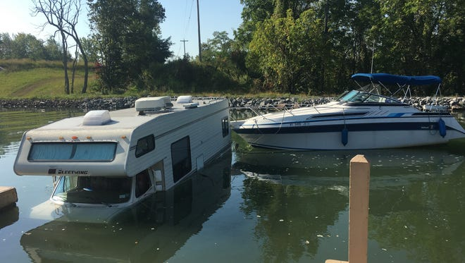 Off the dock, an RV is flooded after going into the Erie Canal, Sunday Sept. 24, 2017.