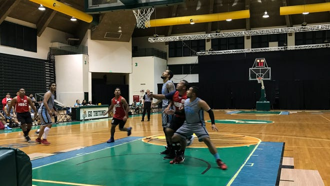 Players from the Harvest Baptist Bible College and Guam Community College fight for posiioning on a rebound during their game Monday night, FEb. 26 at the UOG Calvo Field House.