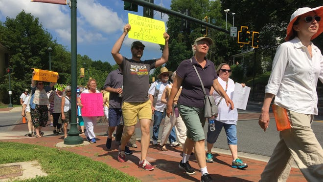 "Participants at the Families Belong Together March at Staunton's Gypsy Hill Park on Saturday, June 30, 2018. They chanted, ""Love not hate makes America great."""
