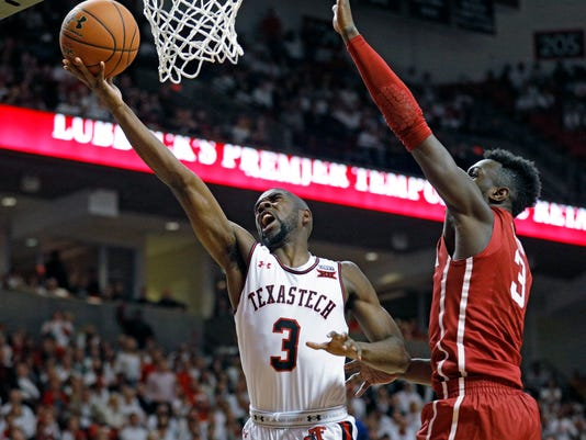Texas Tech's Josh Webster (3) lays up the ball around Oklahoma's Kadeem Lattin (3) during the first half of an NCAA college basketball game Tuesday, Feb. 13, 2018, in Lubbock, Texas. (AP Photo/Brad Tollefson)