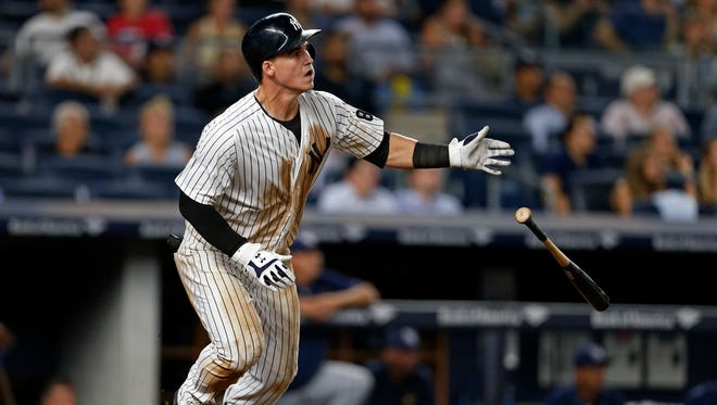New York Yankees' Tyler Austin watches his walk-off home run off Tampa Bay Rays relief pitcher Erasmo Ramirez during the ninth inning of a baseball game Thursday, Sept. 8, 2016, in New York. The Yankees won 5-4.
