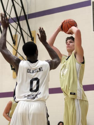 Adam Woodbury takes a shot over Gabe Olaseni during a Prime Time League game.