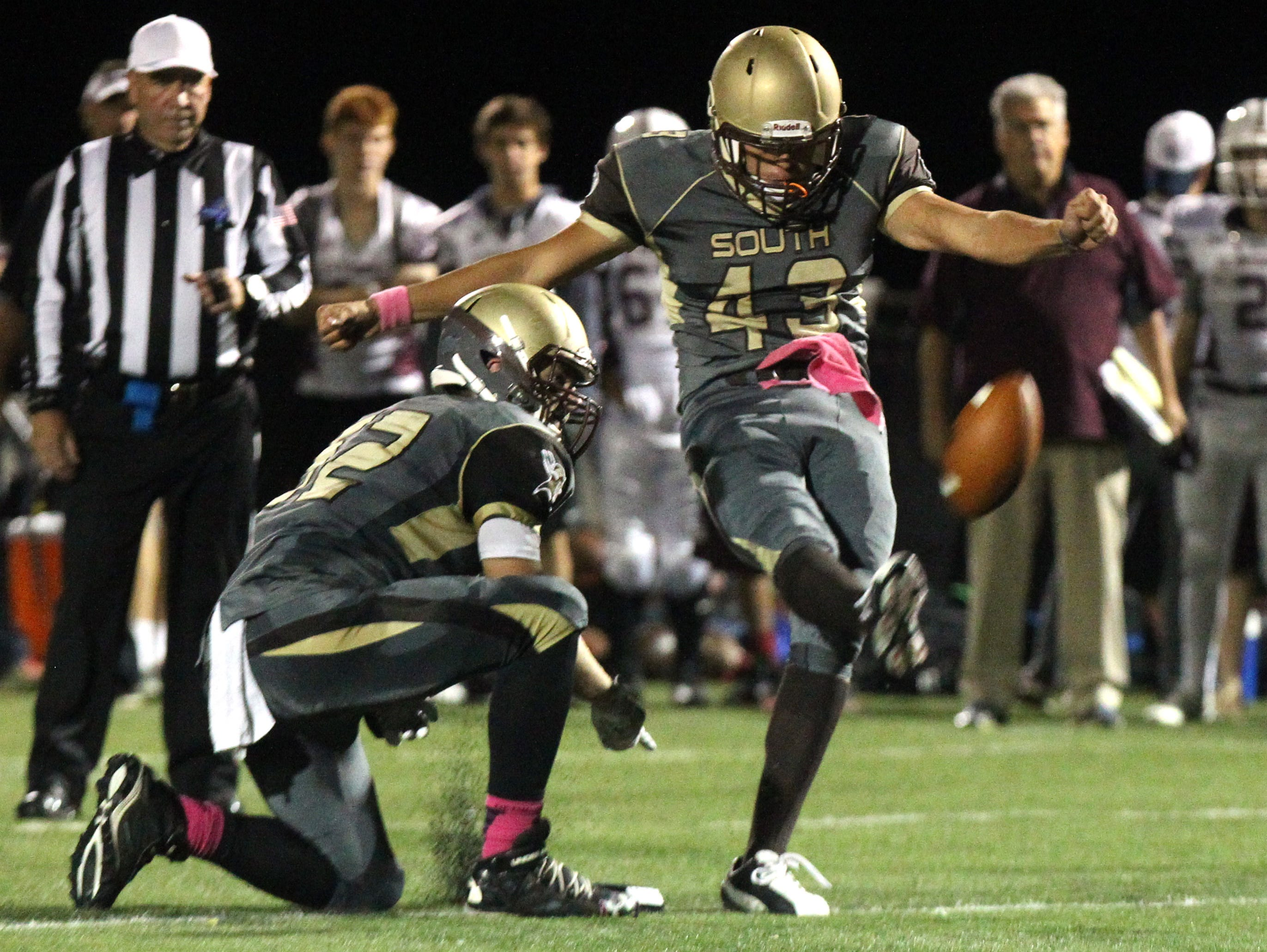 Clarkstown South's Michael Tagaris kicks a field goal during Friday night's game against Scarsdale at Clarkstown South.