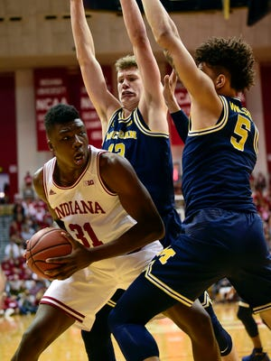 Feb 12, 2017; Bloomington, IN, USA; Indiana Hoosiers center Thomas Bryant is blocked under the basket by Michigan Wolverines forwards Moe Wagner (13) and D.J. Wilson (5) during the first half at Assembly Hall.