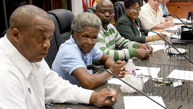 Members of the St. Landry Parish Council discuss the 2017 parish budget during a special meeting Tuesday at the Old City Market.