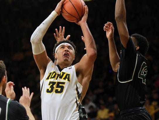 Iowa's Cordell Pemsl goes up for a contested shot during