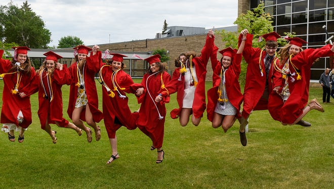 Graduates leap into the air during a group photo taken before the start of the Saturday, June 2, graduation ceremony at Rocori High School in Cold Spring.