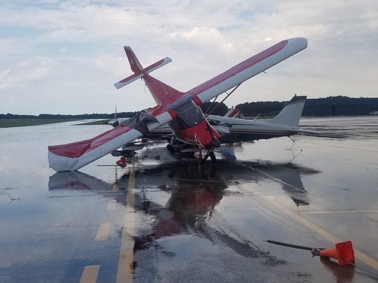 A small prop plane rests atop another aircraft following