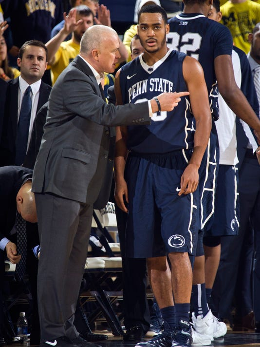 Penn State head coach Patrick Chambers, left, gives instructions to guard Shep Garner (33) during a timeout in the second half of an NCAA college basketball game against Michigan at Crisler Center in Ann Arbor, Mich., Saturday, Jan. 2, 2016. Michigan won 79-56. (AP Photo/Tony Ding)
