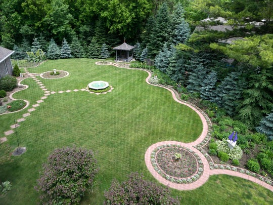 A view from a room atop an old silo affords a good view of the backyard gardens at the home of Helen and Frank Hertneky  in Oconomowoc.