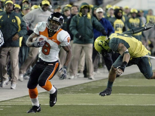 James Rodgers (8) scores the winning touchdown in double overtime of the 2007 Civil War game as Oregon's Patrick Chung (15) chases at Autzen Stadium.