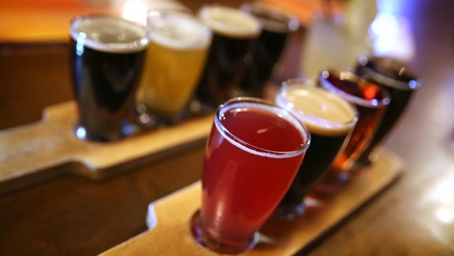 Flights of beer are served up at the Beer Market during a food crawl in Rochester's College Town.