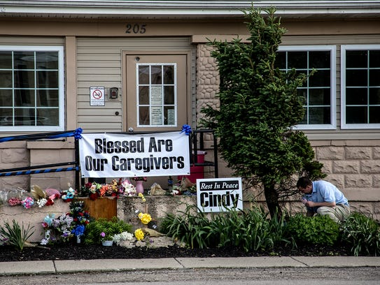 A memorial outside the Pine Kirk Care Center in Kirkersville was created by community members following the triple shooting on May 12, 2017.