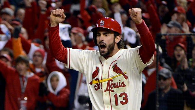 Matt Carpenter celebrates as teammate Carlos Beltran scores a run in the 7th inning.