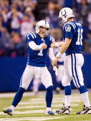 Pat McAfee, of the Colts, congratulates teammate Peyton Manning after the quarterback's long touchdown throw in second quarter action of the Colts loss to the New York Jets at Lucas Oil Stadium, Indianapolis, IN, Saturday, January 8, 2011.