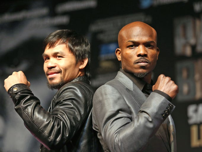 Manny Pacquiao and Timothy Bradley pose for photos for the media at the MGM Grand in Las Vegas, Wednesday, April 9, 2014.
