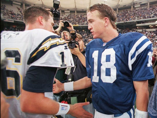 Ryan Leaf, left, meets with Peyton Manning after Manning's