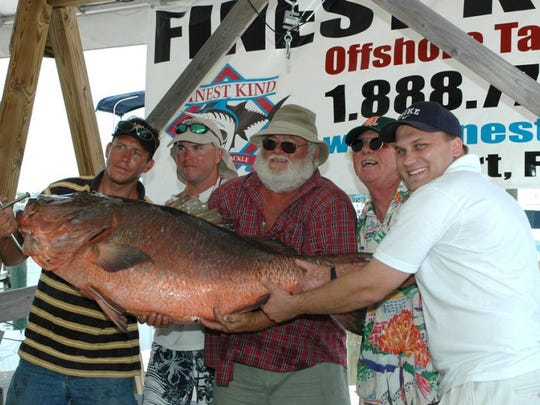 Robert Allred, of Pahokee (center with beard), caught this 102-pound cubera snapper to win the Treasure Coast Builders Association fishing tournament in 2005. (FILE PHOTO)