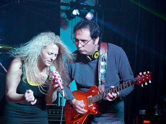 Clayton Hartley performs with band member Manda Kokales-Shaeffer of Solera. Hartley had a heart attack in March, and there will be a fundraiser for him Sunday at the American Legion.