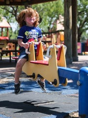 Zander VanZandt, 4, plays at College Hills Unidad Park