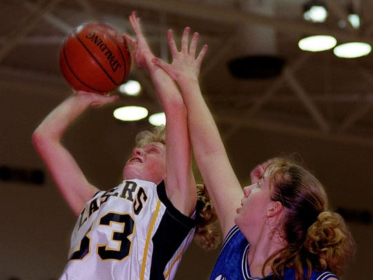 Kettle Moraine's Kelly Schwerman goes up for two as