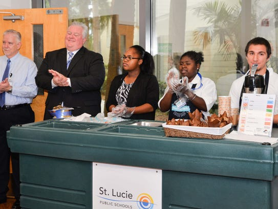 Bill Tomlinson, left, director of Exceptional Student Education; Doug Bader, St. Lucie County Human Resource manager; Ms. Virgil, a Fort Pierce Westwood paraprofessional; Joneicia Sirmons and Alejandro Sanchez, Student Perk students, at the 2017 grand reopening of the coffee kiosk at the St. Lucie County Administration Building in Fort Pierce.